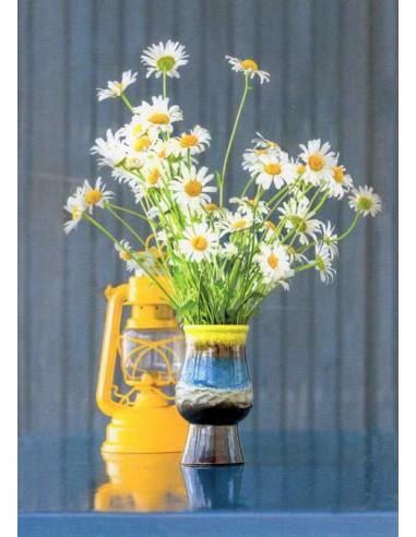 Kukka-asetelma päivänkakkarat